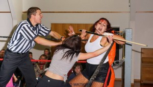 NO DQ: Frankie Quinn chokes Scarlett out during their Street Fight at Maniacs United Retribution. PHOTO: David Watson/Maniacs United